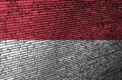 La bandera de Indonesia se representa en la pantalla con el código de programa El concepto de desarrollo moderno de la tecnología imágenes de archivo libres de regalías