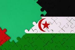 La bandera de Western Sahara se representa en un rompecabezas terminado con el espacio verde libre de la copia en el lado izquier ilustración del vector