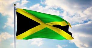 La bandera jamaicana que agita en el viento muestra el símbolo de Jamaica del patriotismo - 4k 3d rendir almacen de video