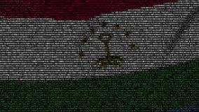 La bandiera d'ondeggiamento del Tagikistan ha fatto dei simboli del testo su uno schermo di computer Animazione loopable concettu archivi video