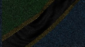 La bandiera d'ondeggiamento della Tanzania ha fatto dei simboli del testo su uno schermo di computer Animazione loopable concettu video d archivio