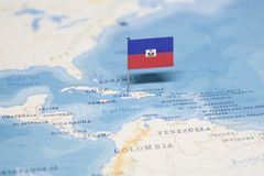 La bandiera dell'Haiti nella mappa di mondo immagine stock