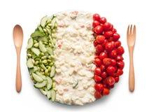 La bandiera dell'Italia ha fatto del pomodoro, dei piselli e dell'insalata Immagine Stock