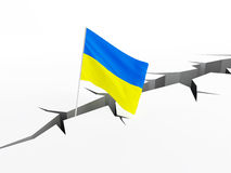 La bandiera dell'Ucraina cade in un crepaccio sulla terra, il crollo del crollo di hryvnia dell'economia Fotografia Stock