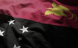 La bandiera della Papuasia Nuova Guinea ha arruffato vicino su immagini stock libere da diritti