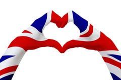La bandiera delle mani del Regno Unito, modella un cuore Concetto del simbolo del paese, isolato su bianco Fotografie Stock Libere da Diritti