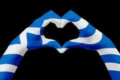 La bandiera delle mani della Grecia, modella un cuore Concetto del simbolo del paese, isolato sul nero Fotografie Stock