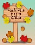 La bannière de vente d'automne, érable coloré de papier de feuille d'arbre, sorbe part sur le fond en bois de texture Conception  Photos stock
