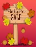 La bannière de vente d'automne, érable coloré de papier de feuille d'arbre, sorbe part sur le fond en bois de texture Conception  Images stock