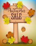 La bannière de vente d'automne, érable coloré de papier de feuille d'arbre, sorbe part sur le fond en bois de texture Conception  Image stock