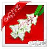 La baratija del Año Nuevo marca 2010 con etiqueta Imágenes de archivo libres de regalías