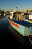 La barca del pescatore nel porto di Trieste Fotografia Stock