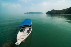 La barca ed il paesaggio Immagine Stock