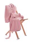 La bata está en la silla Imagen de archivo libre de regalías