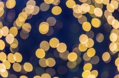 La beauté du bokeh jaune allume le fond de Noël Photographie stock