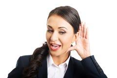 La bella donna di affari origlia Immagini Stock Libere da Diritti