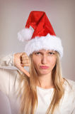 La bella donna di Natale con i pollici giù firma Fotografia Stock Libera da Diritti