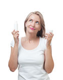 La bella donna sceglie per la crema di cura di pelle Immagine Stock Libera da Diritti