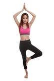 La bella ragazza in buona salute asiatica fa la posa di yoga Immagine Stock Libera da Diritti