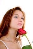 La bella ragazza con è aumentato fotografia stock libera da diritti