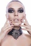 La bella ragazza con gli occhi affumicati compone Fotografie Stock Libere da Diritti