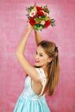 La bella ragazza con i fiori Fotografia Stock