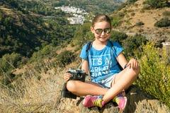 La bella ragazza con la macchina fotografica Immagini Stock