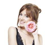 La bella ragazza con pelle perfetta con è aumentato fotografia stock