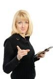 La bella ragazza con un dispositivo di piegatura nero in mani fotografia stock