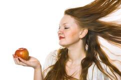 La bella ragazza con una mela Fotografia Stock Libera da Diritti