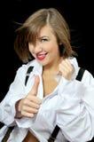 La bella ragazza sorridente mostra bene fotografia stock libera da diritti