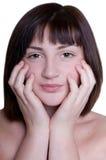 La bella ragazza sta massaggiando il suo fronte Fotografia Stock Libera da Diritti