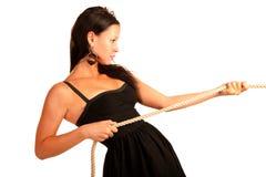 La bella ragazza tiene la corda Fotografie Stock