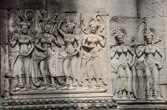 La bella scultura antica sulla pietra a Angkor Wat Fotografia Stock Libera da Diritti