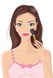 La belle application de femme composent la poudre pour rougir Image libre de droits