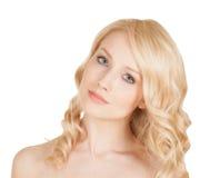 La belle blonde sur le fond d'isolement Photographie stock libre de droits