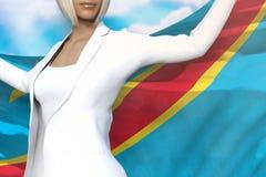 La belle dame d'affaires tient le drapeau du République démocratique du Congo dans des mains derrière son dos sur le fond de ciel illustration libre de droits
