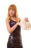 La belle femme recherche quelque chose dans un sac Photographie stock