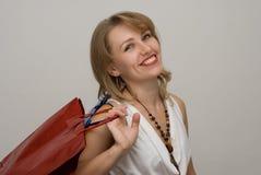 la belle fille achète des jeunes Photos libres de droits