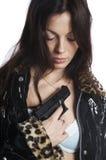 La belle fille avec un pistolet Photo libre de droits