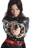 La belle fille avec un pistolet Photographie stock