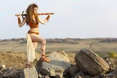 La belle fille avec une épée Photographie stock libre de droits