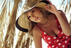La belle fille dans un chapeau Image stock