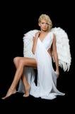 La belle fille dans un procès d'un ange blanc Photographie stock libre de droits