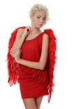 La belle fille dans un procès d'un ange rouge Photographie stock
