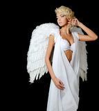 La belle fille dans un procès d'un ange blanc Photo libre de droits