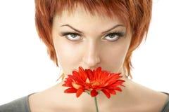 La bellezza con un fiore Immagini Stock Libere da Diritti