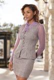Donna elegante di affari in abbigliamento di affari. Immagine Stock