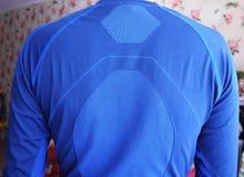La biancheria intima termica dell'uomo, bello tessuto, misura il corpo ed il petto fotografia stock