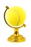 La bille de tennis aiment un globe Images stock